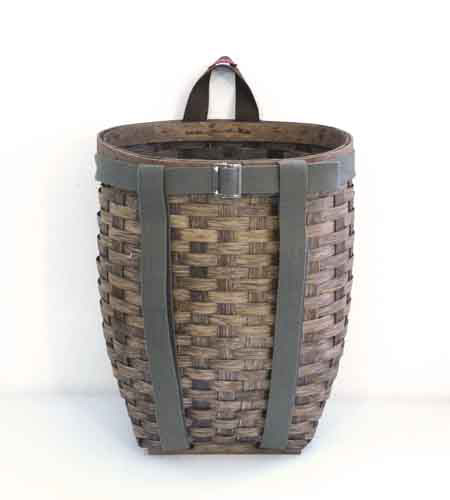This hamper has a woodsy, country feel. Its a versatile piece that can hold anything from laundry to kids' toys. (brookfarmgeneralstore.com)