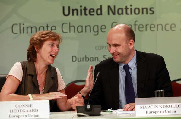 European Union (EU) Commissioner Connie Hedegaard, left, and Polish Environment Minster and rotating President of the EU Marcin Korolec gesture at each other during the closing press conference of the Durban climate change negotiations, 11 December 2011. AFP / Getty Images