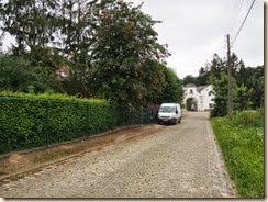 Gingelom, Kamerijckstraat: links de Kamerijckmolen. Midden achteraan de hoeve Kamerijck, tevens B&B
