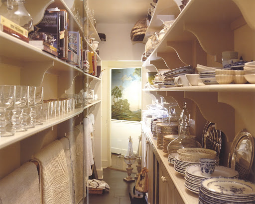 This space acts as the laundry room and pantry at Whilton Farm in the foothills of the Blue Ridge Mountains in Virginia.  This previously unused passageway makes all items easily visible and reachable.