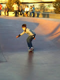 Kai at the Denver skate park, learning to ride