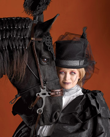 Ghostly Equestrienne: With reddened eyes, a ghostly pallor, and her midnight steed Rutger by her side, Martha was instantly transformed into a haunted horsewoman for the cover of the 2009 Halloween issue.