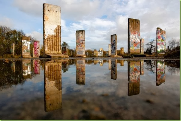 berlin wall relics reflecting in pond