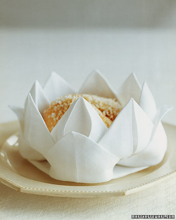 This napkin fold, favored by the famous French chef August Escoffier, is one of several for presenting individual rolls.