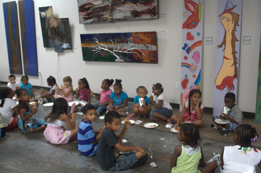 The children celebrate the end of the Arts in the Park summer program. (Photo by: Kenrick Nobles)