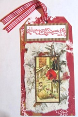 2011 Holiday Christmas tag with handmade paper santa