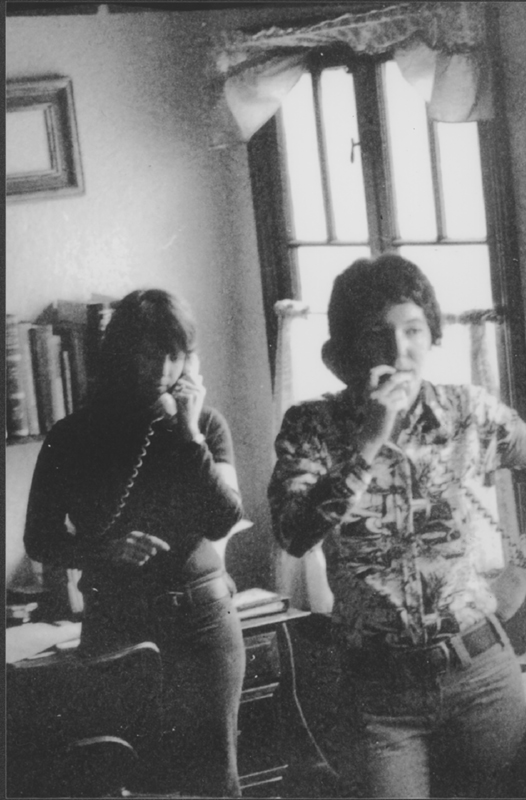 Tess Tessier and her lover Shorty (in background) in Barb McClean's house, the headquarters of the First National Lesbian Conference, just days before the event. April 1973.