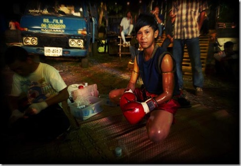 Thailand, Isan region, Buriram, Wat Sarbua Buddhist temple festival, Muay Thai kick boxing in temple, Lo Ma young girl boxer