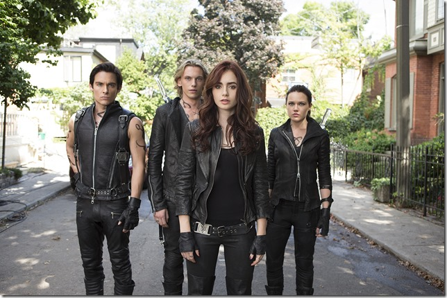 Alec (Kevin Zegers), Jace (Jamie Campbell Bower), Clary (Lily Collins), Isabelle (Jemima West) in Screen Gems fantasy-action THE MORTAL INSTRUMENTS: CITY OF BONES.