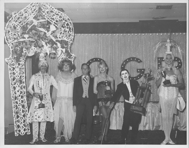 Awards handed out onstage at the Gay Girls Riding Club Halloween party. 1972.