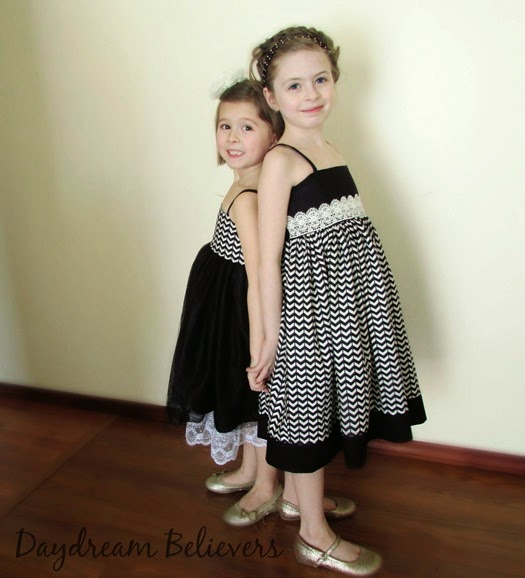 LOVE this sister set of black and white dresses by Daydream Believers! Gorgeous, modern, handcrafted clothing for girls. Swoon!