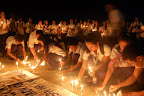 Students of Cavite State University light candles on the eve of the third anniversary of the Ampatuan massacre. (Photo courtesy of College Editors Guild of the Philippines-Southern Tagalog)