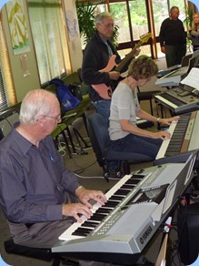 Peter Brophy (foreground) harmonizing with Denise and Brian Gunson