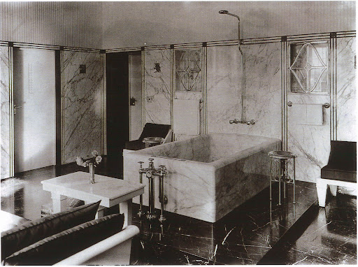 Hoffman used malachite and three different types of marble (statuario, black and bleu-belge) to create this amazing master bathroom. If this were mine I'd never leave.