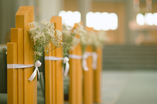 Small bundles of baby's breath decorated the church's pews.