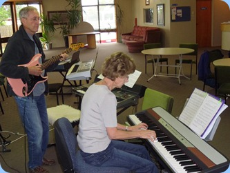 Denise Gunson playing Peter Brophy's Korg SP-250 digital piano with husband, Brian, accompanying on guitar.