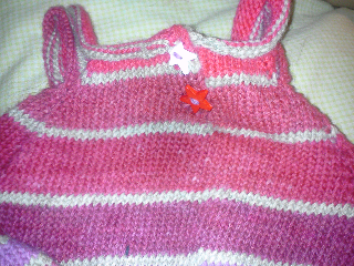 Back of the pink dress showing red and white start buttons