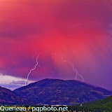 An August evening greets Bonner Mountain with two shocking lightshows at once.