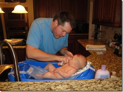 23.  Daddy giving bath
