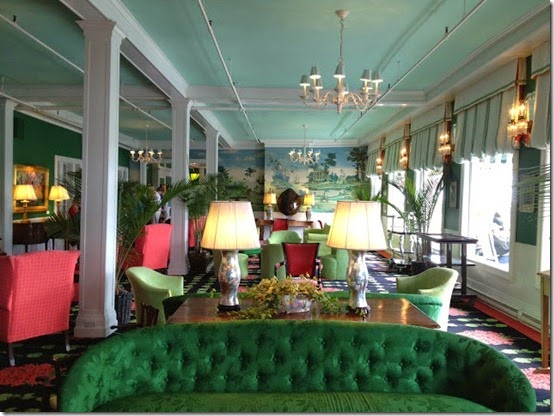 Grand Hotel green tufted sofa