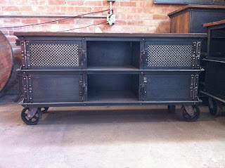 "63"" x 20"" x 32"" T Ellis console, 2 mesh/2 solid doors, and an open center"
