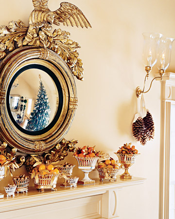 This gorgeous Federal mirror is hung above a mantel in Martha's summer house in Bedford that is lined with old Paris porcelain filled with citrus.(marthastewart.com)