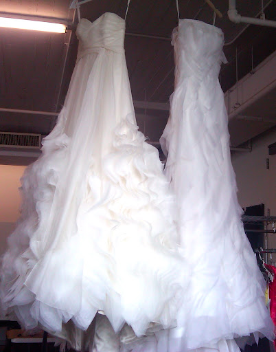 The best way to steam a wedding dress is to hang it from a high place. That way, the weighty skirt can flow free and help pull out any wrinkles.