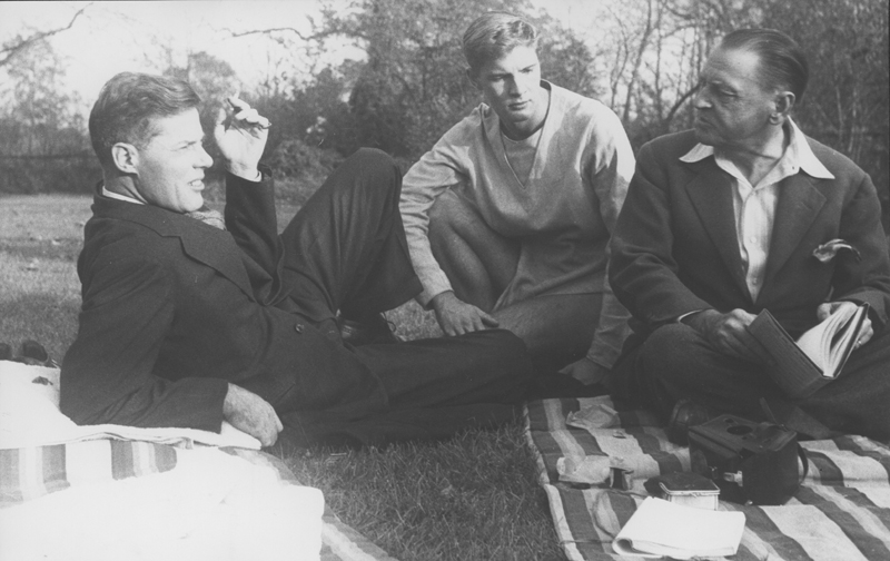 Model Christian William (Bill) Miller (center) with William Somerset Maugham (right) on the grounds at Stoneblossom [unknown location]. Circa 1947.