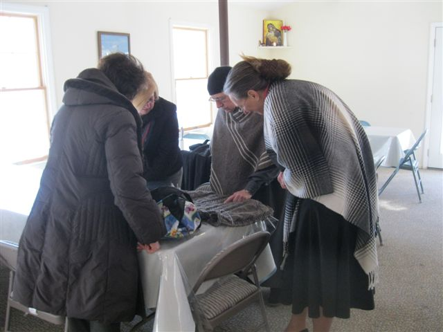 Mother explains a sweater she is knitting from the monastery's sheeps' wool.