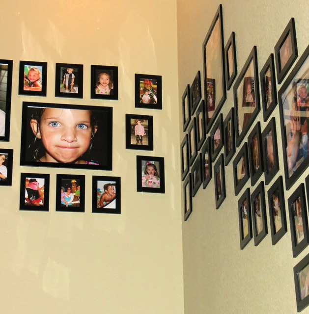 use velcro to hang pictures on stairway 3