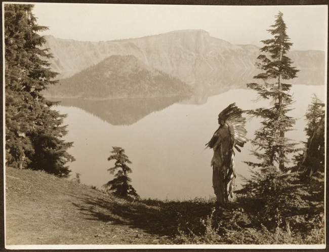 Title: The chief--Klamath.   Date Created/Published: c1923.   Summary: Photograph shows Klamath Indian chief in ceremonial headdress standing on hill overlooking lake, California or Oregon.   Photograph by Edward S. Curtis, Curtis (Edward S.) Collection, Library of Congress Prints and Photographs Division Washington, D.C.
