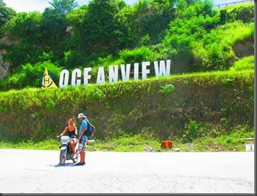 photo of oceanview marina samal island sign