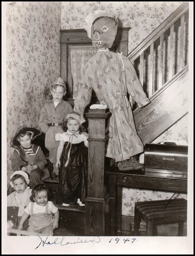 The stairs at Grandma Weber's house were a favorite playing place for cousins.  Here are five of those little ones posed by their parents on Halloween 1947.