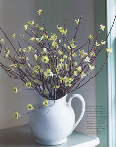 Greenish-white dogwood blossoms seem to flutter above an oversize white pitcher. (The Best of Martha Stewart Living -- Arranging Flowers)