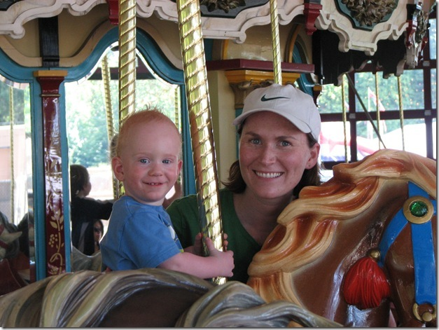 Alex and Mama on carousel at zoo (2)