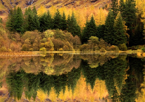 An astonishing reflection of contrasting colours and shapes results in this dramatic image of Glencoe in Scotland
