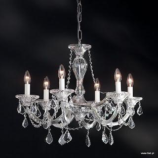Żyrandol z kryształami. Chromowane wykończenie, kryształowe ramiona. Wys 530 mm, Średnica 650 mm, światło 6 x 40W E14 typu świeca.