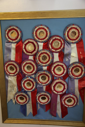 So many impressive looking ribbons!  They must really know what they are doing here.