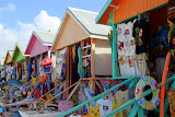 Colorful Beach Bungalows Converted To Souvenir Shops At Long Bay - St. George's, Antigua