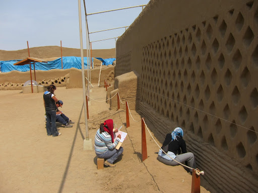 Archeologists working on a section of a wall at Chan Chan