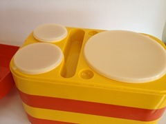 orange and yellow Ingrid stacking plastic picnic tray set
