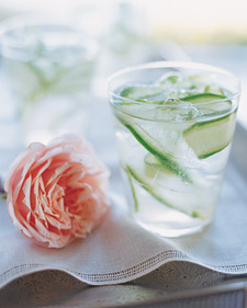 To make these cocktails, cucumber-infused vodka is garnished with cucumber ribbon and mixed with ginger simple syrup.