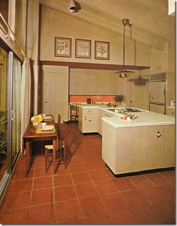 "Without a single window opening directly to the ""out-of-doors,"" the Pace Setter kitchen still has an open, spacious feeling. This is achieved by a wall of glass opening into the garden room, bathing the room with non-glare daylight yet permitting the eye to travel far beyond the confines of the room. Featured in the September 1961 issue."