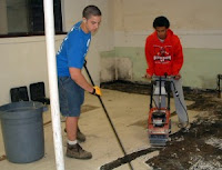 Jordan Miller and Chance Miller tear up the vinyl floor.  Photo Courtesy:  Iowa Mennonite School
