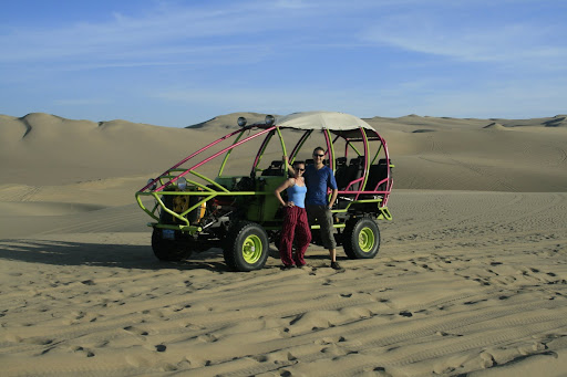 Lynette and I in front of our death buggy that careered over the dunes with a complete disregard for human life.
