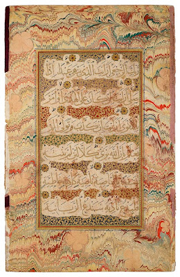 "Qur˒anic Leaf from the Read Persian Album From the Read Persian Album. Probably from the Deccan (Golconda), late sixteenth century. On paper. Sometimes beautifully written and framed Qur˒anic passages were preserved in albums. This magnificent leaf originally must have faced a page that began with Muḥammad's first revelation (610), sura 96.1—5 (Iqraa, or ""Read!"" or ""Proclaim""), also known as al-˓Alaq (""The Clot of Congealed Blood""), as the present leaf contains verses 8–18. The names come from the verses: Read! (or Proclaim) in the name of your Lord and Cherisher, Who created—created man, out of a [mere] clot of congealed blood. . . .Proclaim . . . He Who taught [the use] of the pen. The six lines of muḥaqqaq script contain ten short ayat (verses), each ending with a gold rosette. Marbling (abri, or ""clouds,"" in Persian) was known in Persia by the sixteenth century, when named abri masters are documented."