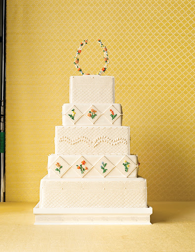 This cake served as the main inspiration. Rosma loved the piped details, square shape, and the diamonds on the alternating tiers.