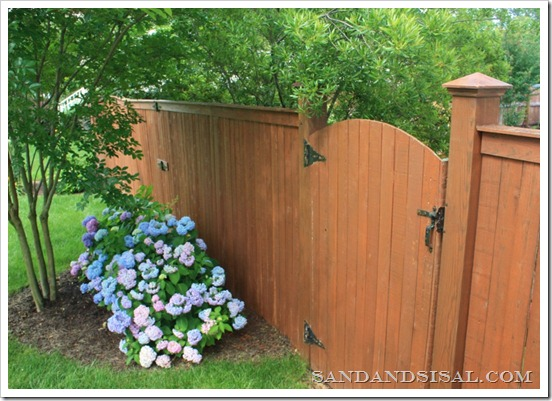 Copper Capped Fence with Hydrangeas
