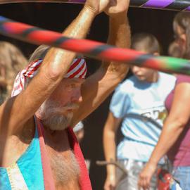 Street Performer by D Clark  / B  Worthington - People Musicians & Entertainers ( performer, hoop, fun, man )