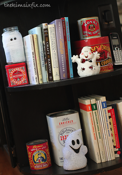 Ghosts on bookshelf
